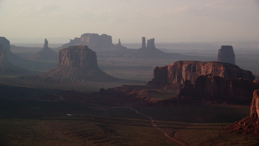 6K stock footage aerial video of flying by Merrick Butte, Elephant Butte in Monument Valley, Utah, Arizona, twilight Aerial Stock Footage | AX133_064