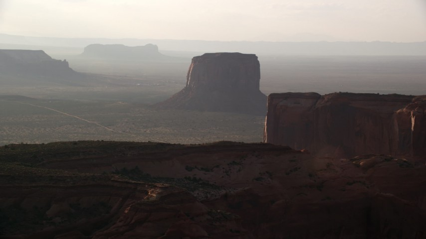 6K stock footage aerial video of approaching Mitchell Butte in Monument Valley, Utah, Arizona, twilight Aerial Stock Footage | AX133_073