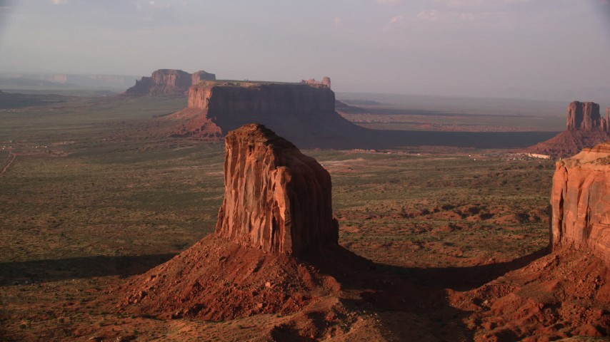 Flying by Gray Whiskers Butte, Monument Valley, Utah, Arizona, twilight Aerial Stock Footage | AX133_077