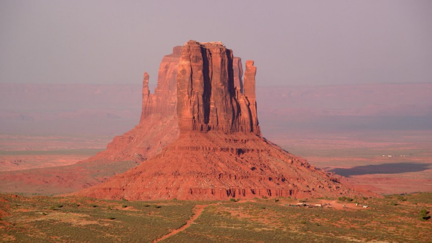6K stock footage aerial video flyby West Mitten Butte to reveal East Mitten Butte, Monument Valley, Utah, Arizona, twilight Aerial Stock Footage | AX133_084