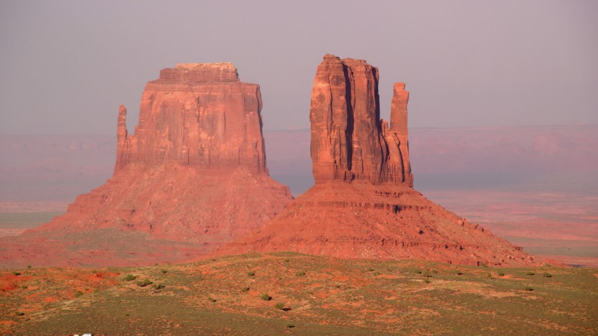 6K stock footage aerial video of flying by East and West Mitten Buttes, Monument Valley, Utah, Arizona, twilight Aerial Stock Footage | AX133_085