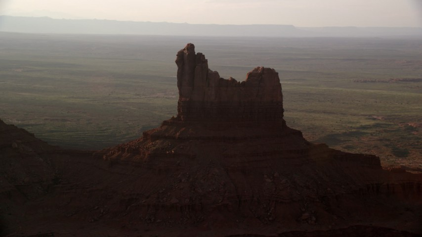 6K stock footage aerial video of Setting Hen Butte in Monument Valley, Utah, Arizona, twilight Aerial Stock Footage | AX133_092