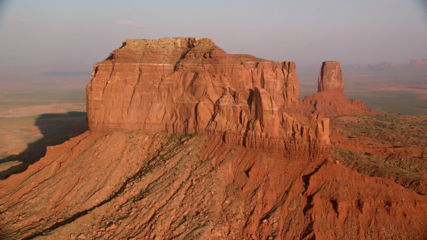 6K stock footage aerial video flying by side of Brighams Tomb Butte, Monument Valley, Utah, Arizona, sunset Aerial Stock Footage | AX133_094