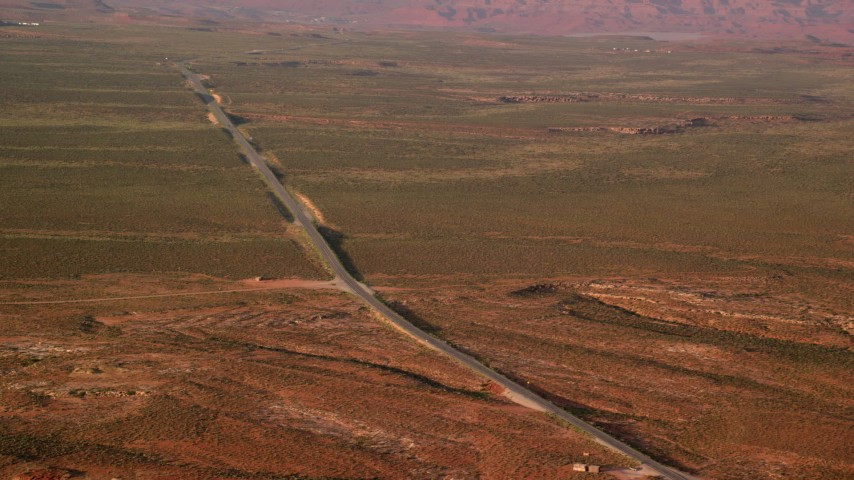 6K stock footage aerial video of passing by Highway 163 in Monument Valley, Utah, Arizona, twilight Aerial Stock Footage | AX133_099
