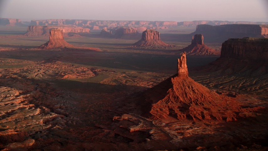 6K stock footage aerial video approach Big Indian Butte, view of nearby buttes, Monument Valley, Utah, Arizona, twilight Aerial Stock Footage AX133_133 | Axiom Images