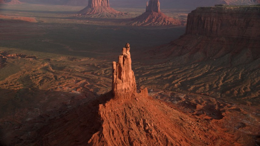 Approach, tilt down over Big Indian Butte, Monument Valley, Utah, Arizona, twilight Aerial Stock Footage | AX133_135
