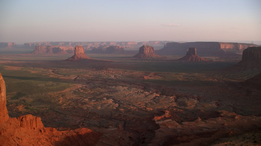 6K stock footage aerial video of a wide view of buttes and mesas in famous Monument Valley, Utah, Arizona, sunset Aerial Stock Footage | AX133_151