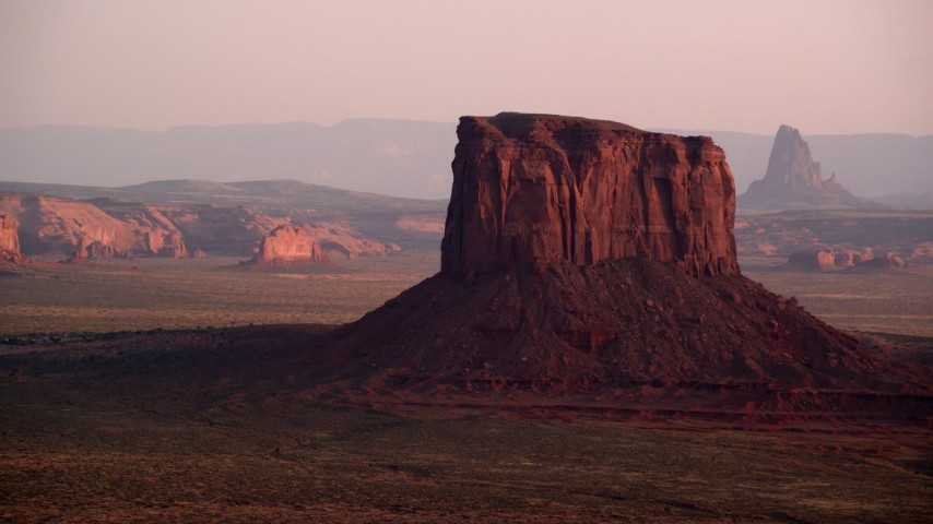 6K stock footage aerial video of passing by Mitchell Butte, Monument Valley, Utah, Arizona, sunset Aerial Stock Footage | AX133_159