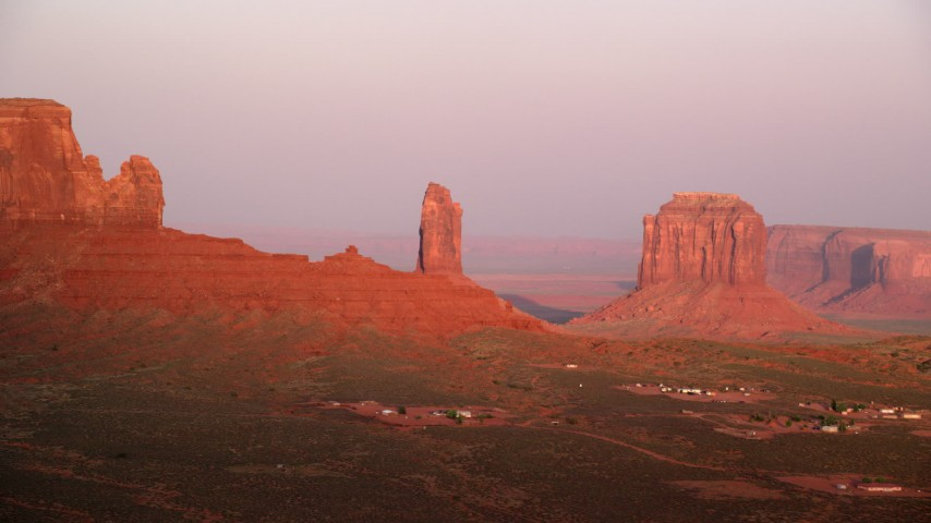 Flying by West Bitten Butte, Merrick Butte, Monument Valley, Utah, Arizona, sunset Aerial Stock Footage | AX133_162