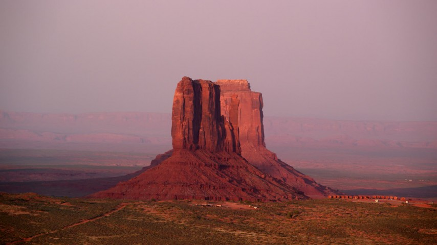 Fly by West Mitten Butte, East Mitten Butte, Monument Valley, Utah, Arizona, sunset Aerial Stock Footage | AX133_167