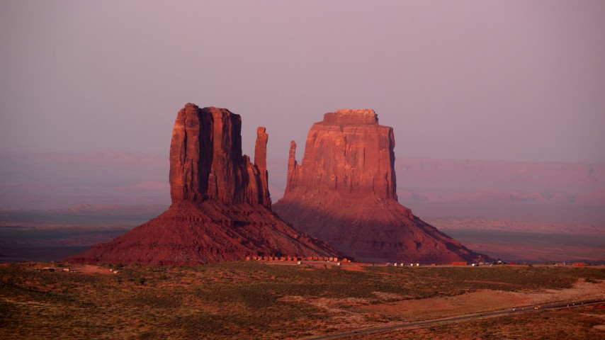 Fly by West Mitten Butte, East Mitten Butte, Monument Valley, Utah, Arizona, sunset Aerial Stock Footage AX133_168