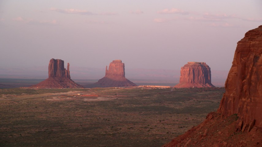 Flying by buttes, The View Hotel, Monument Valley, Utah, Arizona, sunset Aerial Stock Footage | AX133_170