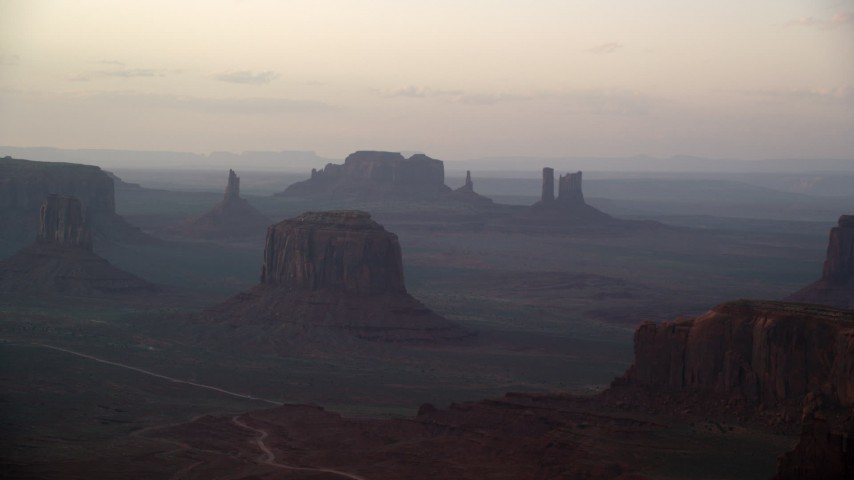 6K stock footage aerial video of a wide view of Merrick Butte and nearby buttes in Monument Valley, Utah, Arizona, sunset Aerial Stock Footage | AX133_181