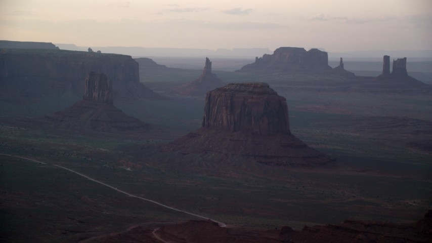 6K stock footage aerial video of passing by West Mitten Butte, Merrick Butte in Monument Valley, Utah, Arizona, sunset Aerial Stock Footage | AX133_182