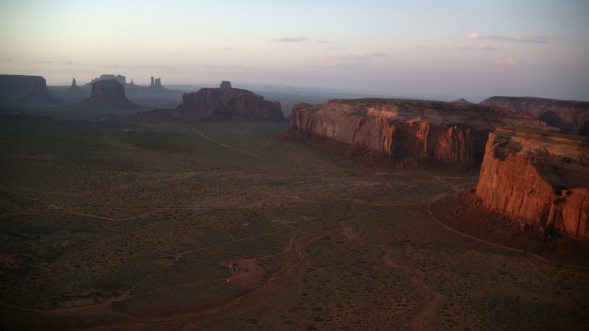 6K stock footage aerial video of approaching Rain God Mesa near buttes, Monument Valley, Utah, Arizona, sunset Aerial Stock Footage | AX133_187
