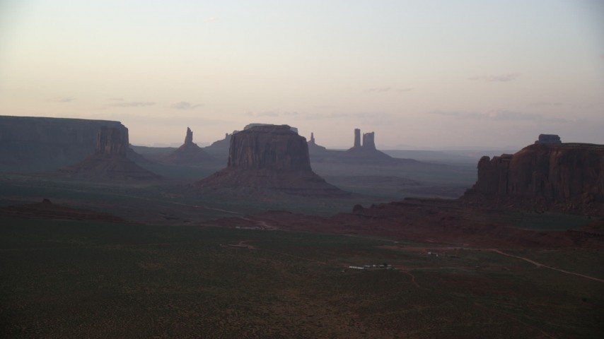 6K stock footage aerial video approach West Mitten Butte and Merrick Butte in Monument Valley, Utah, Arizona, sunset Aerial Stock Footage | AX133_189
