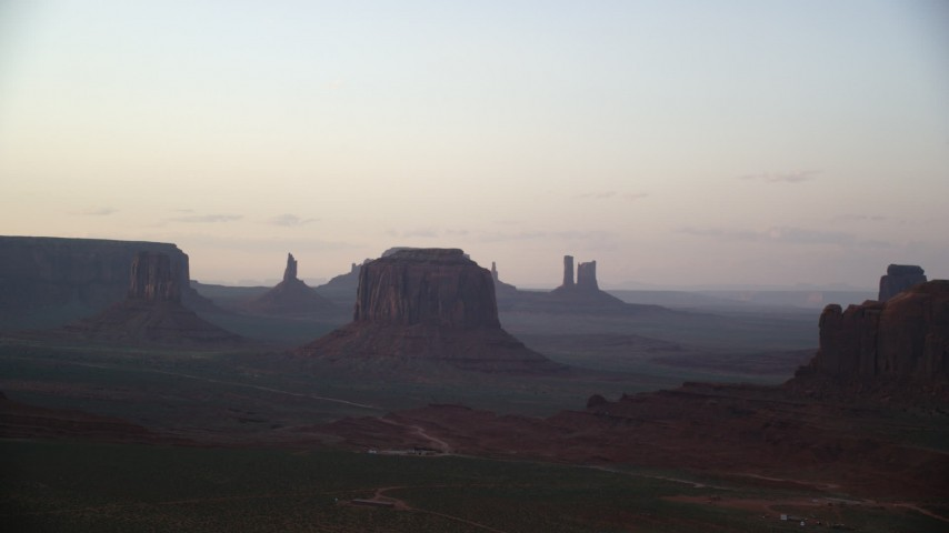 6K stock footage aerial video of an approach to West Mitten Butte and Merrick Butte, Monument Valley, Utah, Arizona, sunset Aerial Stock Footage | AX133_190
