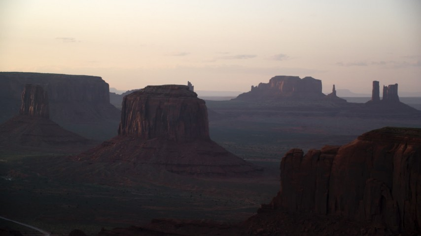 6K stock footage aerial video flyby Merrick Butte, reveal Elephant Butte in Monument Valley, Utah, Arizona, sunset Aerial Stock Footage | AX133_193