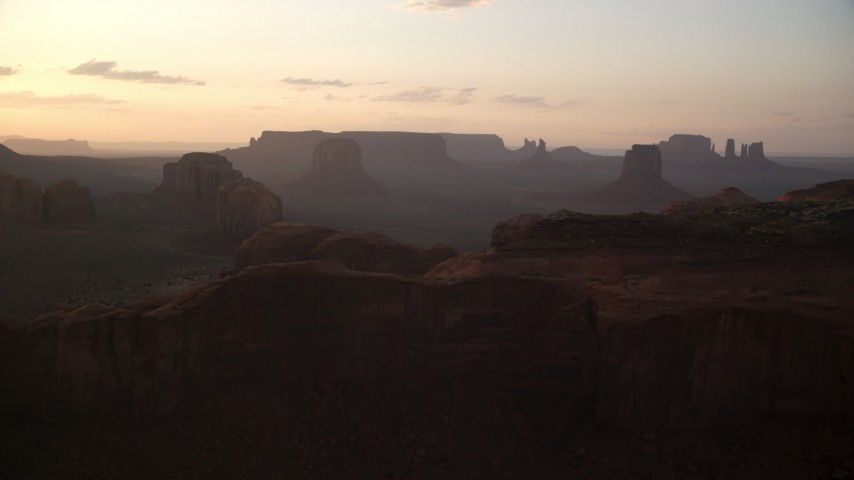 6K stock footage aerial video of approaching Spearhead Mesa in Monument Valley, Utah, Arizona, twilight Aerial Stock Footage | AX133_201