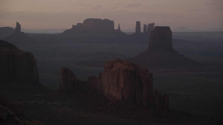 6K stock footage aerial video of flying by Camel Butte, East Mitten Butte in Monument Valley, Utah, Arizona, twilight Aerial Stock Footage | AX133_213