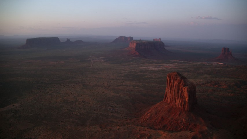 6K stock footage aerial video wide view of Gray Whiskers Butte, Sentinel Mesa in Monument Valley, Utah, Arizona, twilight Aerial Stock Footage | AX133_226
