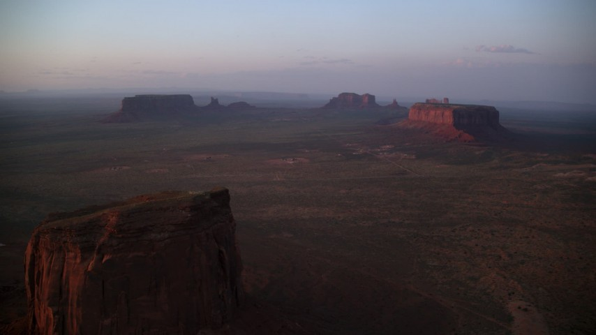 6K stock footage aerial video of Eagle Mesa and Sentinel Mesa in Monument Valley, Utah, Arizona, twilight Aerial Stock Footage | AX133_228