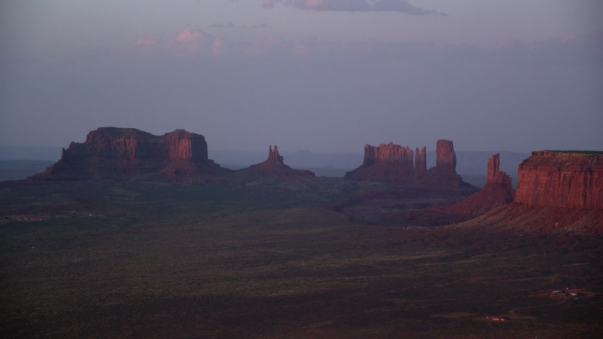 6K stock footage aerial video of buttes in thick haze, Monument Valley, Utah, Arizona, twilight Aerial Stock Footage | AX133_230