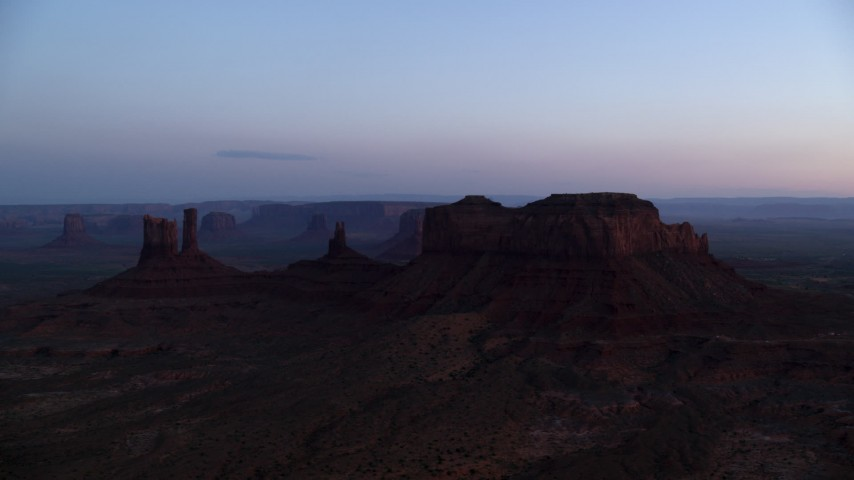 Flying by buttes, Monument Valley, Utah, Arizona, twilight  Aerial Stock Footage | AX134_017