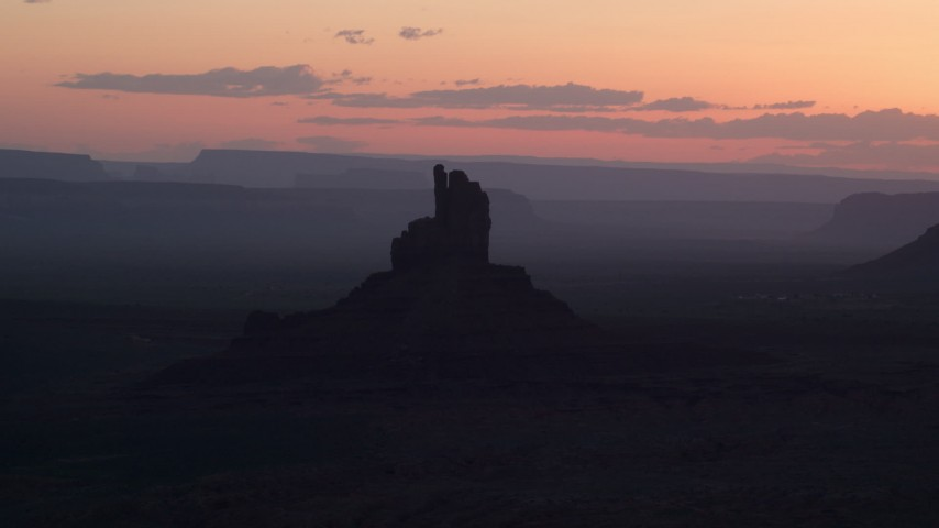 Flying by Big Indian Butte, Monument Valley, Utah, Arizona, twilight  Aerial Stock Footage | AX134_026