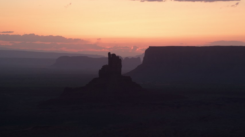 6K stock footage aerial video of flying by Big Indian Butte and Sentinel Mesa, Monument Valley, Utah, Arizona, twilight Aerial Stock Footage | AX134_028