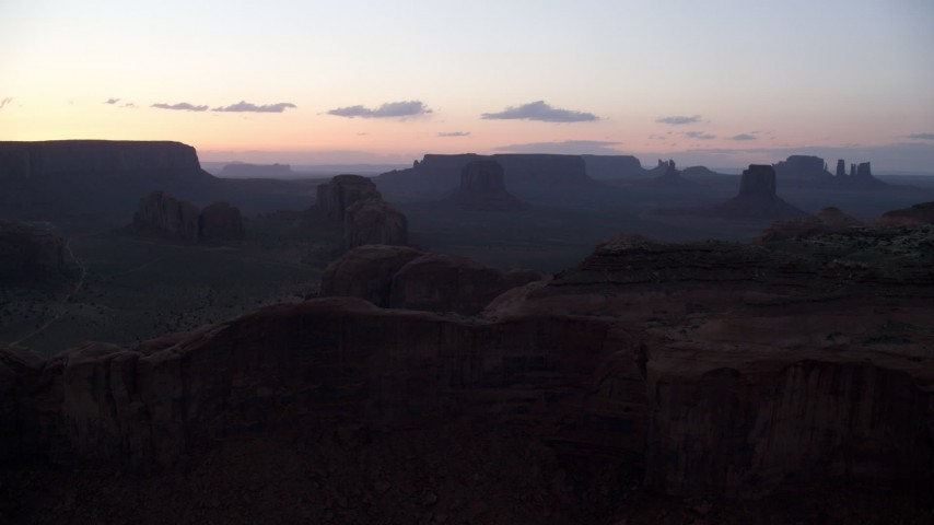 6K stock footage aerial video of passing desert buttes and mesas in Monument Valley, Utah, Arizona, twilight Aerial Stock Footage | AX134_038