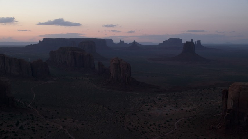6K stock footage aerial video a view of desert buttes and mesas at twilight in Monument Valley, Utah, Arizona Aerial Stock Footage | AX134_040