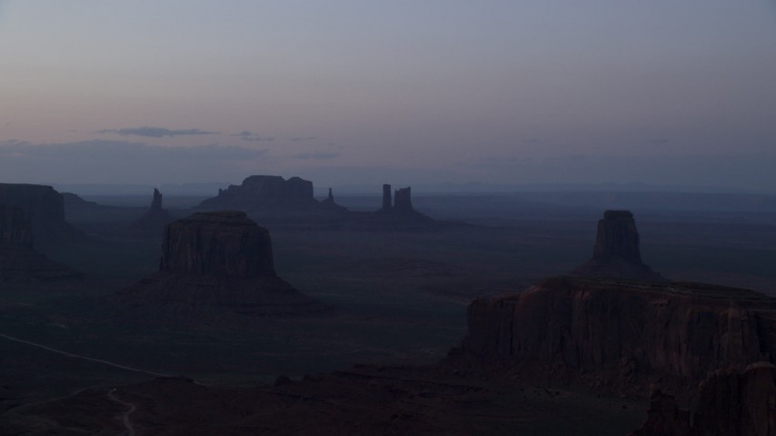 6K stock footage aerial video wide view of desert buttes in famous Monument Valley, Utah, Arizona, twilight Aerial Stock Footage | AX134_045