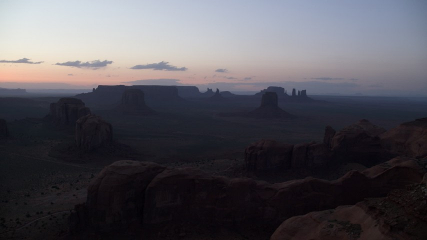 6K stock footage aerial video of desert buttes and mesas, Monument Valley, Utah, Arizona, twilight Aerial Stock Footage | AX134_050