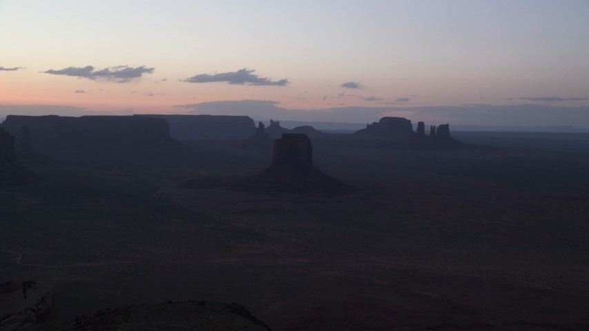 6K stock footage aerial video of flying by East Mitten Butte, mesas, and buttes in Monument Valley, Utah, Arizona, twilight Aerial Stock Footage | AX134_052