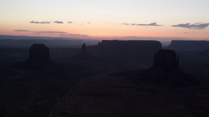 6K stock footage aerial video of Merrick Butte, East Mitten Butte in Monument Valley, Utah, Arizona, twilight Aerial Stock Footage | AX134_055