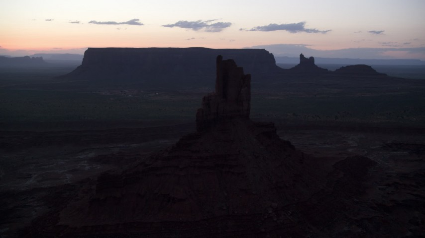 6K stock footage aerial video of flying by Big Indian Butte in Monument Valley, Utah, Arizona, twilight Aerial Stock Footage | AX134_062