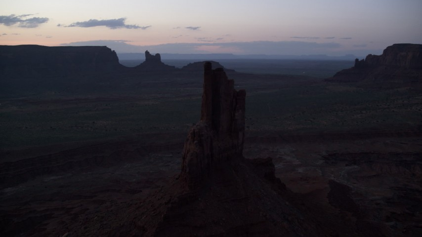 6K stock footage aerial video of passing by Big Indian Butte in Monument Valley, Utah, Arizona, twilight Aerial Stock Footage | AX134_063