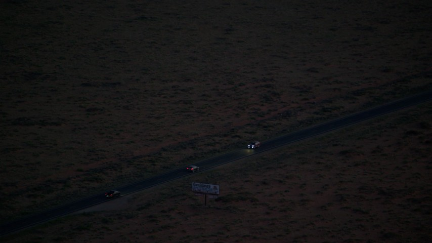6K stock footage aerial video track SUV on highway in desert, Monument Valley, Utah, Arizona, twilight Aerial Stock Footage | AX134_069