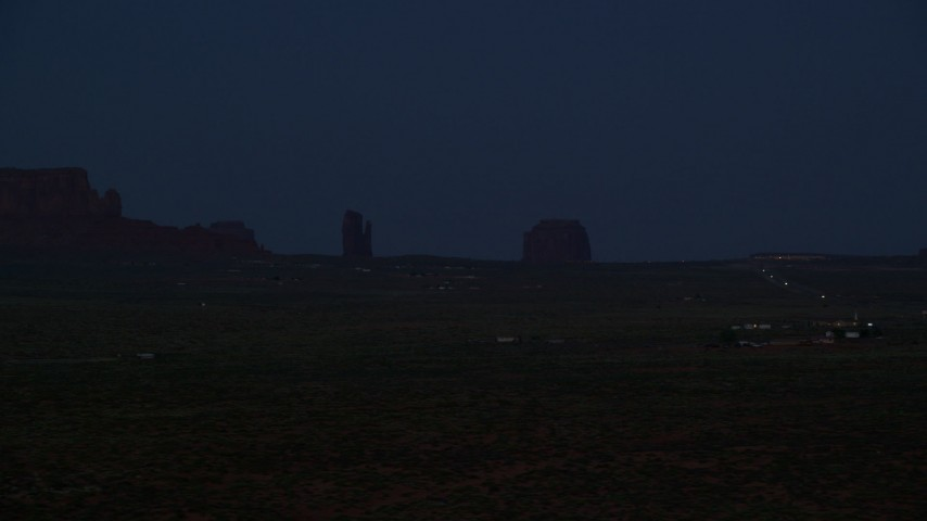 6K stock footage aerial video of West Mitten Butte, Merrick Butte in Monument Valley, Utah, night Aerial Stock Footage | AX134_074