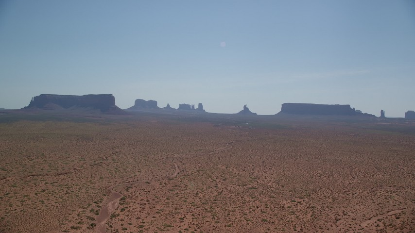 6K stock footage aerial video of approaching buttes and mesas across desert, Monument Valley, Utah, Arizona Aerial Stock Footage | AX135_001