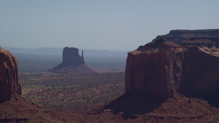 6K stock footage aerial video of flying by buttes, mesas, and The View Hotel, Monument Valley, Utah, Arizona Aerial Stock Footage | AX135_011