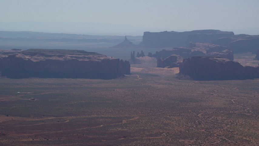 Approaching Rain God Mesa, Thunderbird Mesa, Monument Valley, Utah, Arizona Aerial Stock Footage | AX135_013