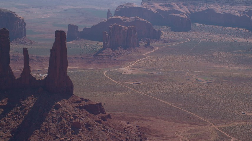 6K stock footage aerial video flyby Three Sisters buttes, Camel Butte, Elephant Butte in Monument Valley, Utah, Arizona Aerial Stock Footage | AX135_016