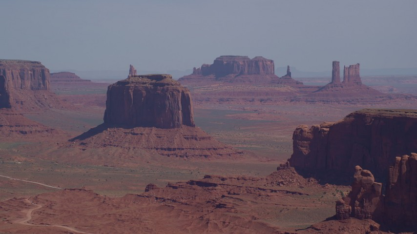 6K stock footage aerial video flying by Merrick Butte, Camel Butte, Elephant Butte in Monument Valley, Utah, Arizona Aerial Stock Footage | AX135_020