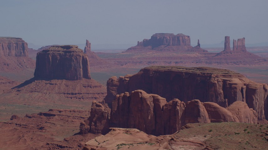 Fly by Merrick Butte, Camel Butte, Elephant Butte, Monument Valley, Utah, Arizona Aerial Stock Footage | AX135_021