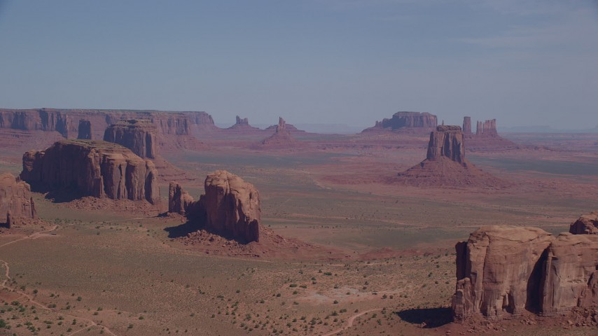 6K stock footage aerial video wide view of buttes, seen from Spearhead Mesa in Monument Valley, Utah, Arizona Aerial Stock Footage | AX135_023