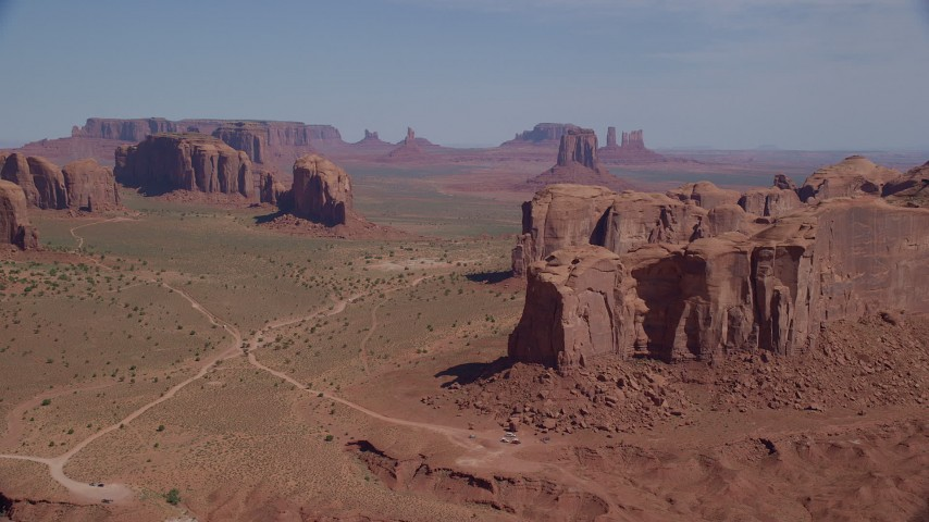 Approaching Spearhead Mesa, Monument Valley, Utah, Arizona Aerial Stock Footage | AX135_027