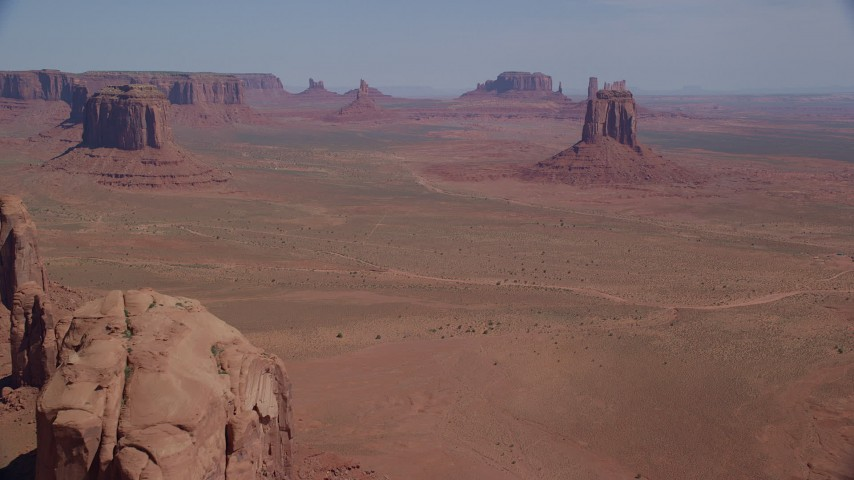 6K stock footage aerial video of approaching several buttes from Cly Butte in Monument Valley, Utah, Arizona Aerial Stock Footage | AX135_031