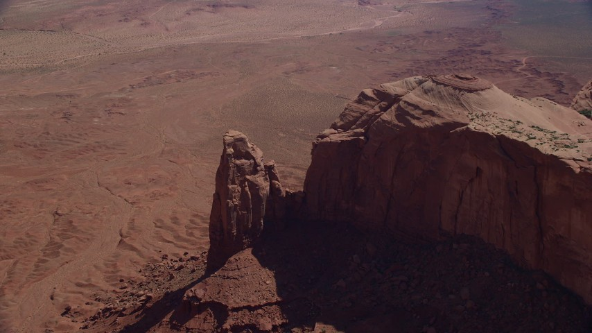 6K stock footage aerial video of approaching rock formation in Monument Valley, Utah, Arizona Aerial Stock Footage   AX135_032